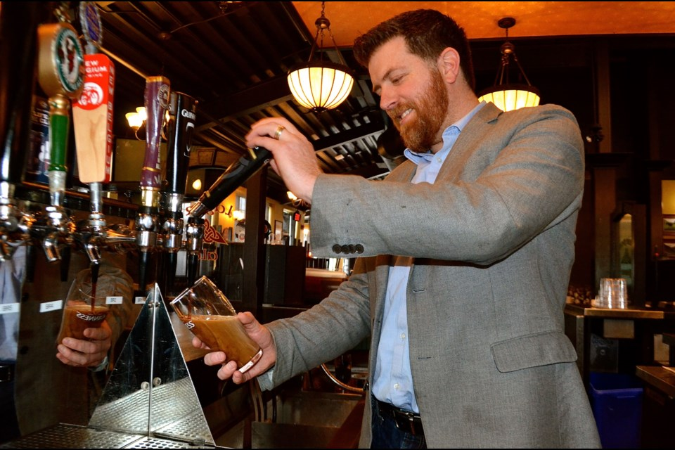 Sean Mangan demonstrates the art of pouring a perfect pint of Guinness. Troy Bridgeman for GuelphToday.com