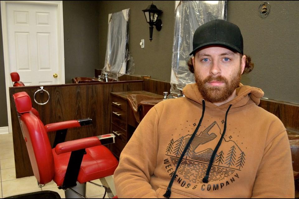 Alexander Ross owner of Royal Crown Barbershop on Edinburgh Road. Troy Bridgeman for GuelphToday.com
