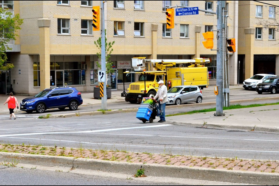 Community activist Ed Pickersgill arrives with supplies for The Bench.  Troy Bridgeman for GuelphToday.com