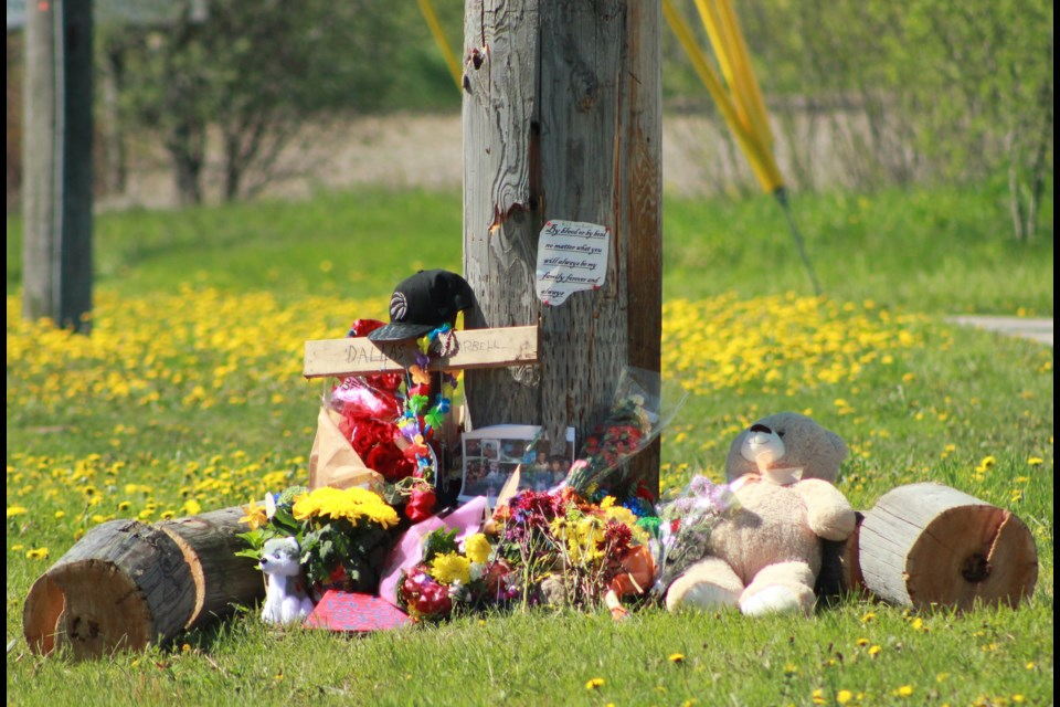 Flowers and messages placed at the scene. Anam Khan/GuelphToday