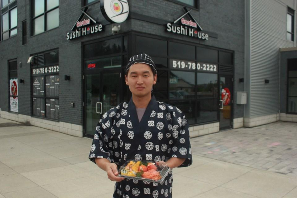 Sushi chef Sam Ma holds a tray of fresh made sushi. Anam Khan/GuelphToday