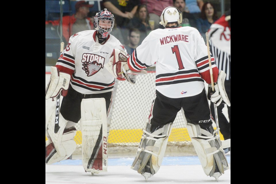 Nico Daws, left, and Tanner Wickware tap gloves as they exchange spots midway through Saturday's exhibition game at the Sleeman Centre against the Peterborough Pets. Tony Saxon/GuelphToday