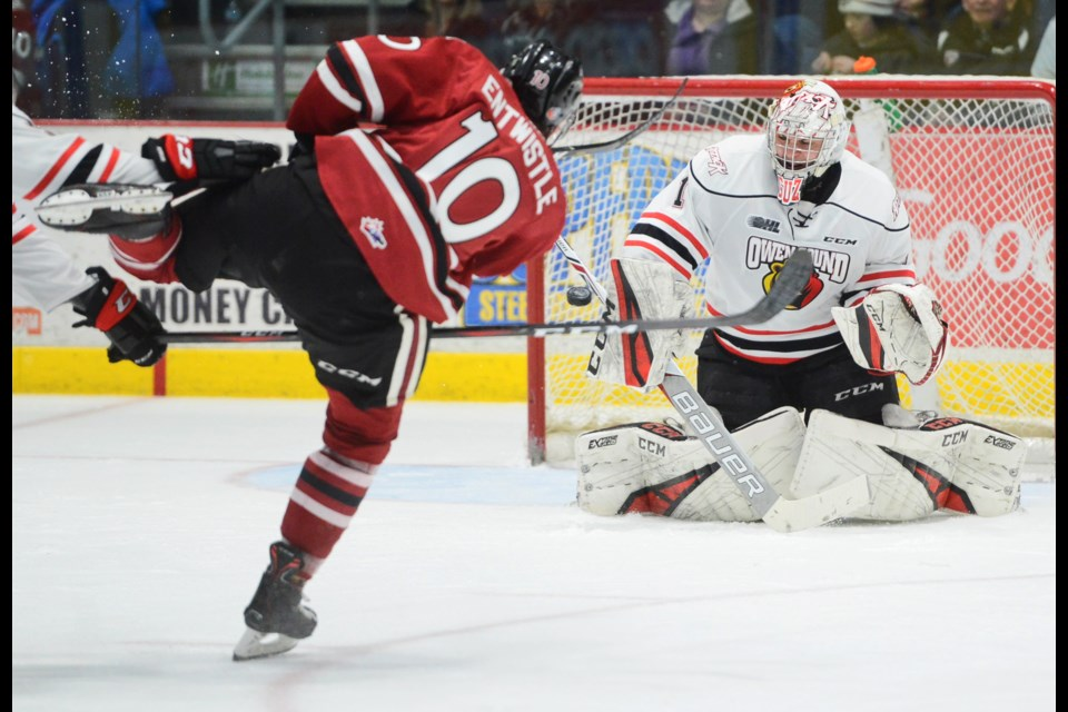 The Guelph Storm's MacKenzie Entwistle beats Owen Sound goaltender Mack Guzda on a breakaway Friday at the Sleeman Centre. Tony Saxon/GuelphToday