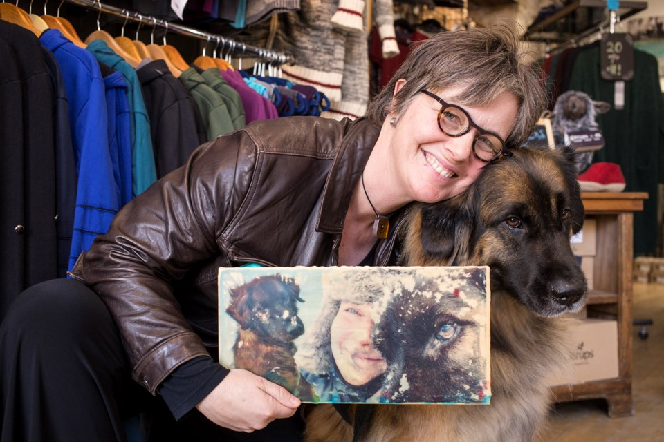 Julianna Murphy and her PTSD service dog Char seen at the opening of her show Saturday at Persephone's Wardrobe on Wilson St. Kenneth Armstrong/GuelphToday