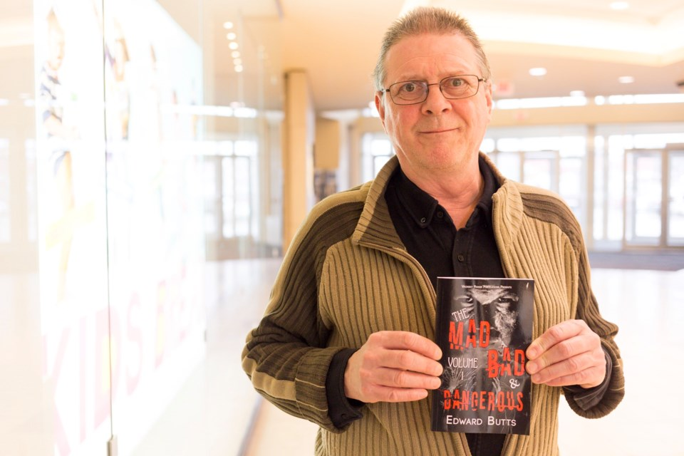 Author Ed Butts poses with a copy of his newest book. Kenneth Armstrong/GuelphToday