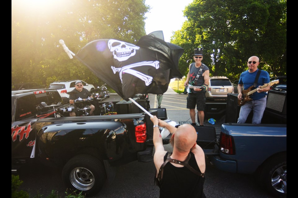 Cover band Wicked Truth lives out the rock and roll dream in the Shakespeare Arms parking lot Thursday. Tony Saxon/GuelphToday