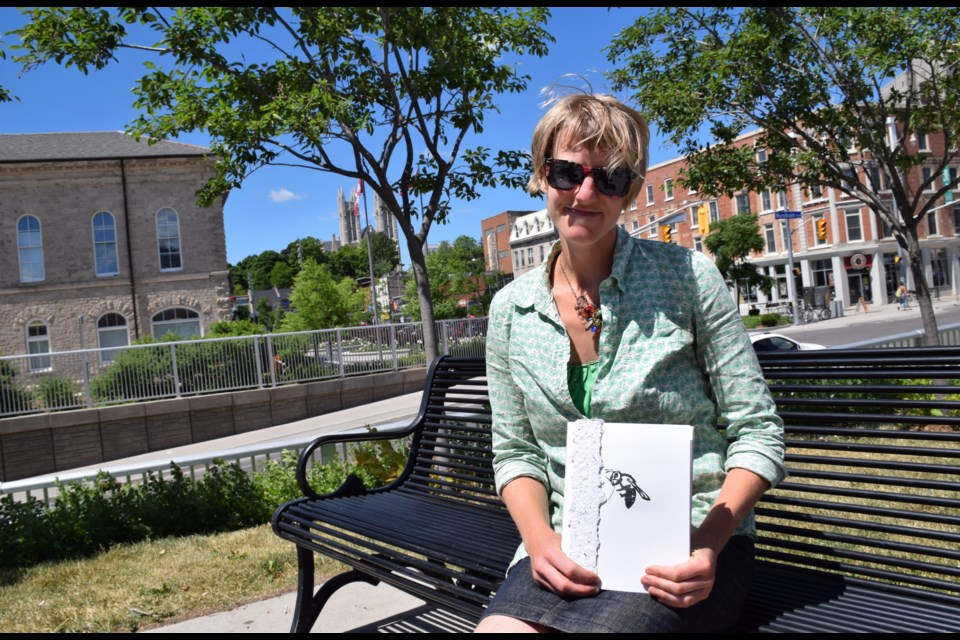 Artist Christina Kingsbury with a copy of the book ReMediate, part of an ongoing environmental art project that began at a former landfill site.
