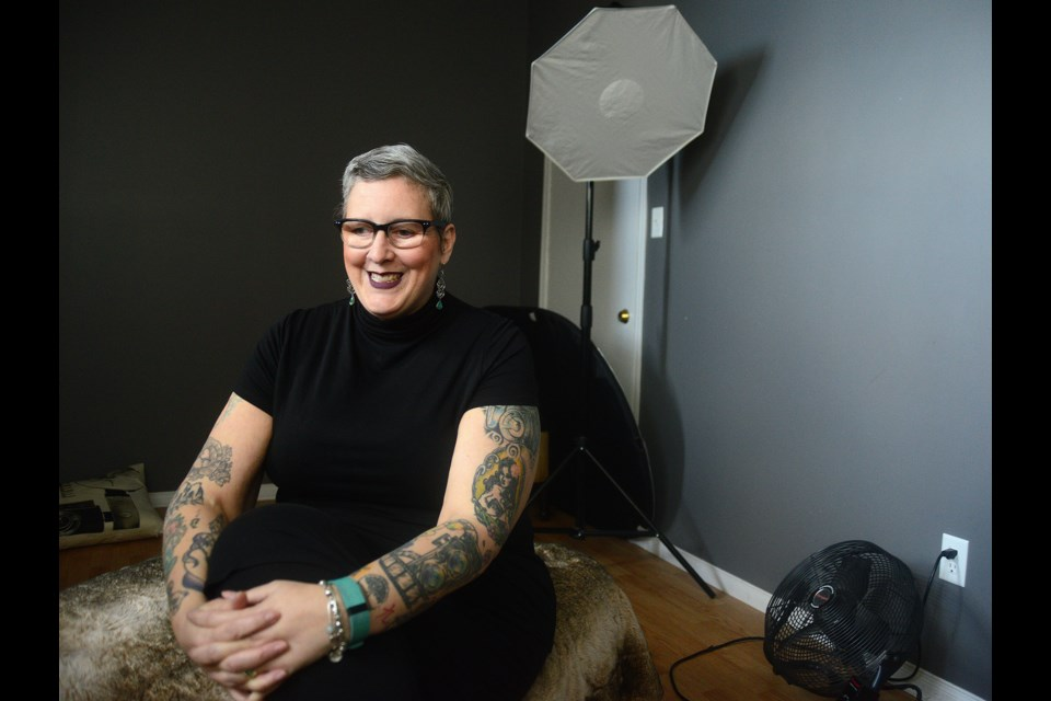 Guelph photographer Julia Busato sits in the basement studio of her home on the city's west side. Tony Saxon/GuelphToday
