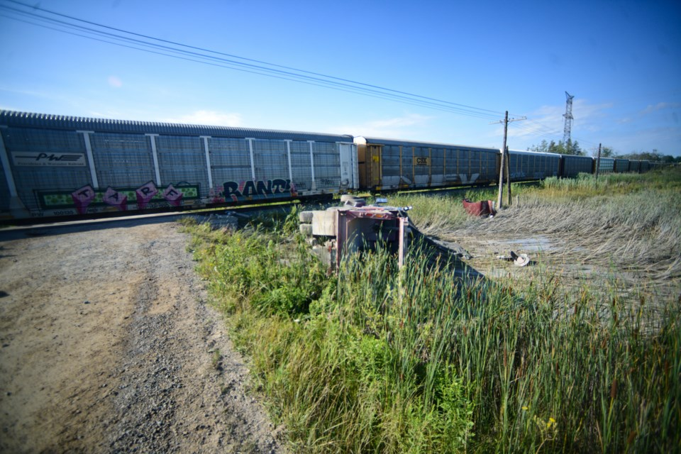 A dump truck and freight train collided on a rural road south of Guelph Wednesday morning. Tony Saxon/GuelphToday