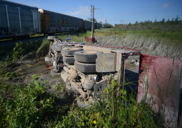 Dump truck collides with freight train (4 photos) (UPDATED)