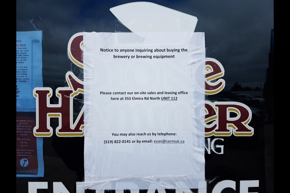 A notice on the door of StoneHammer Brewing on Elmira Road says the company is in bankruptcy proceedings. GuelphToday photo