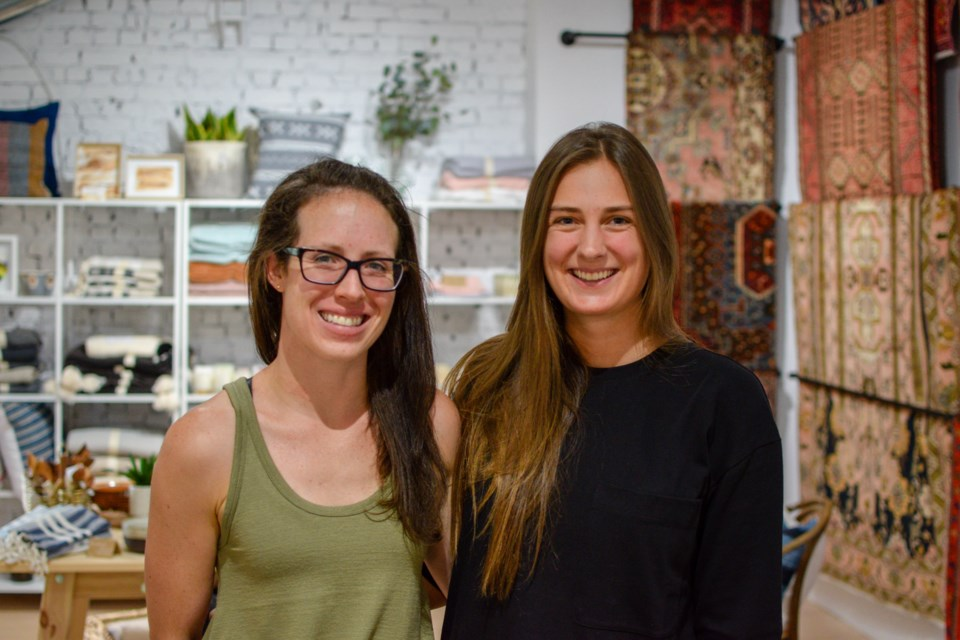 Rug & Weave co-owner Sara McBean, left, stands with staff member Kristina Billsborough. Brianna Bell for GuelphToday.com