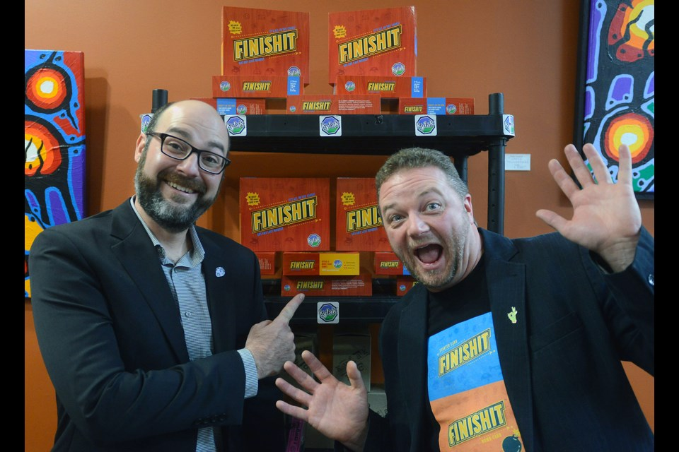 Guelph entrepreneurs Jeff Huber, left, and Jamie Doran launched their new board game FINISHIT at The Boardroom Cafe on Wyndham Street on Saturday, Dec. 3, 2016. Tony Saxon/GuelphToday