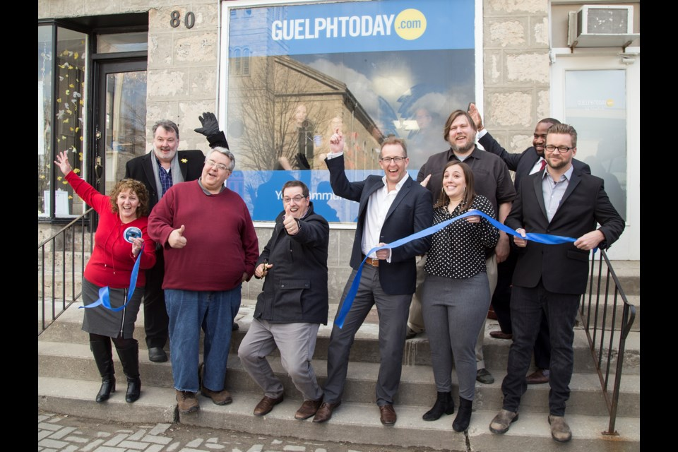 The ribbon is cut for the new GuelphToday office on Norfolk Street on Thursday. Photo by Nicole Parks.