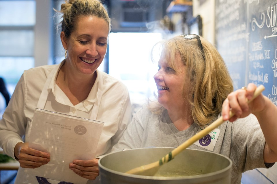 Volunteers check their creation during a Soup Sisters Guelph event held Monday. Kenneth Armstrong/GuelphToday