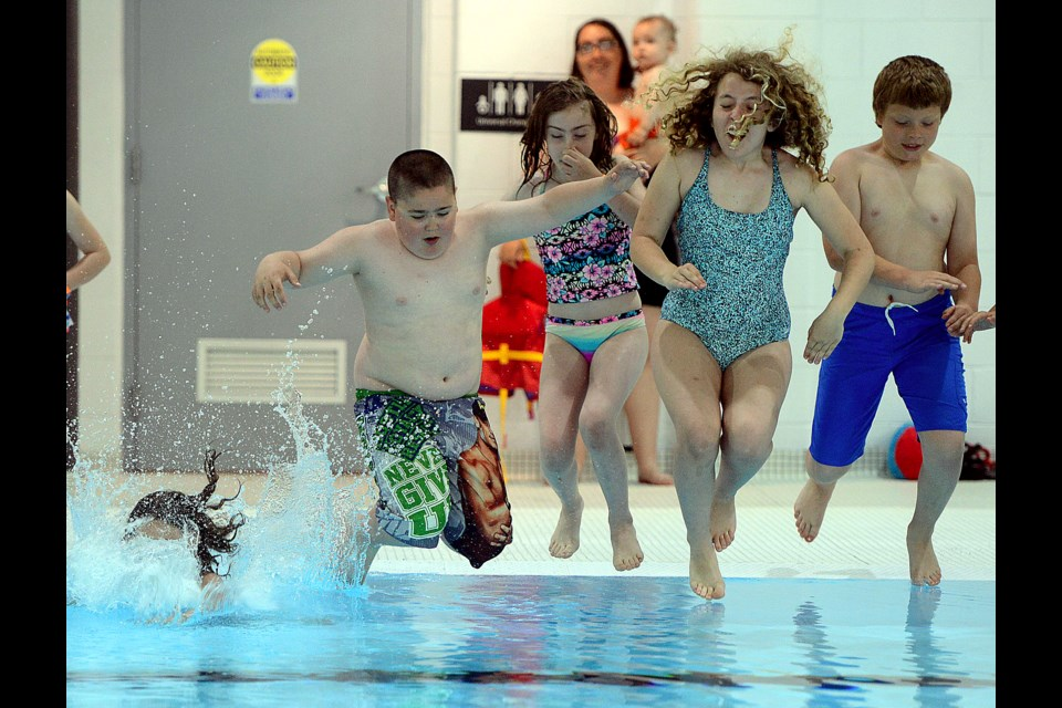Children leap into the Victor Davis Pool at the Victoria Road Recreation Centre Saturday, June 24, 2017, after it was officially reopened after a $15 million renovation. Tony Saxon/GuelphToday