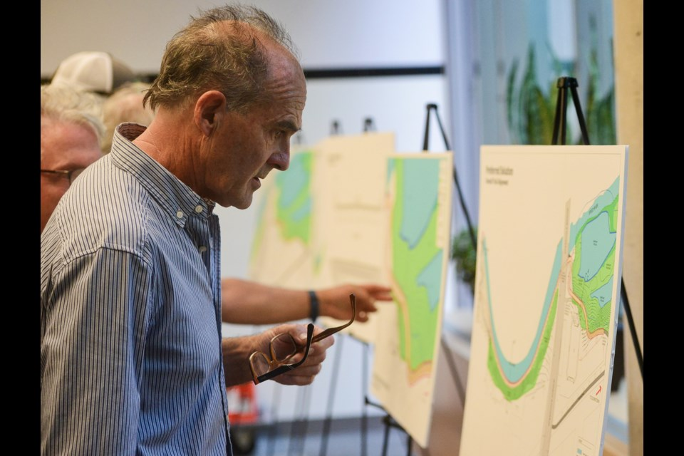 Mike Darmon checks out the plans of city staff's preferred option for new Speedvale Avenue underpass at an open house Thursday, Sept. 13, 2018, at city hall. Tony Saxon/GuelphToday