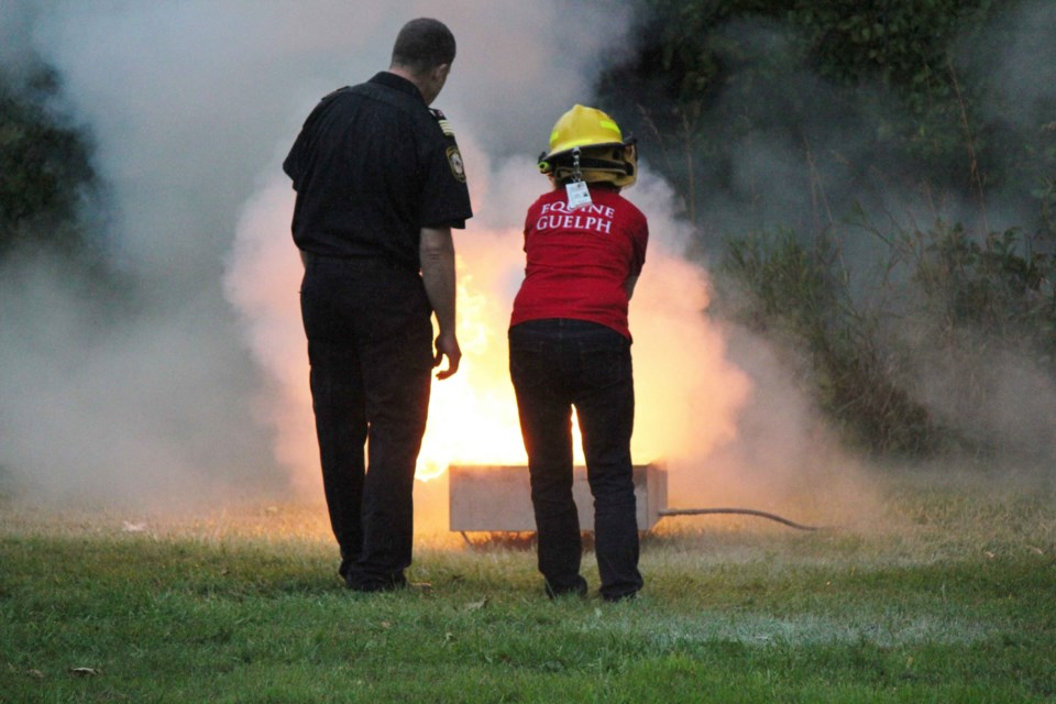 Participants practice fire extinguishing techniques last fall at Equine Guelph's technical large animal emergency rescue training. Photo by Toni Macpherson.