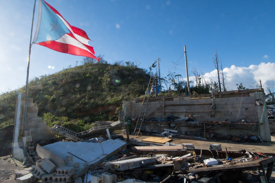 In the mountains of Puerto Rico, a flag flies over a home destroyed by hurricane Maria. Philip Maher