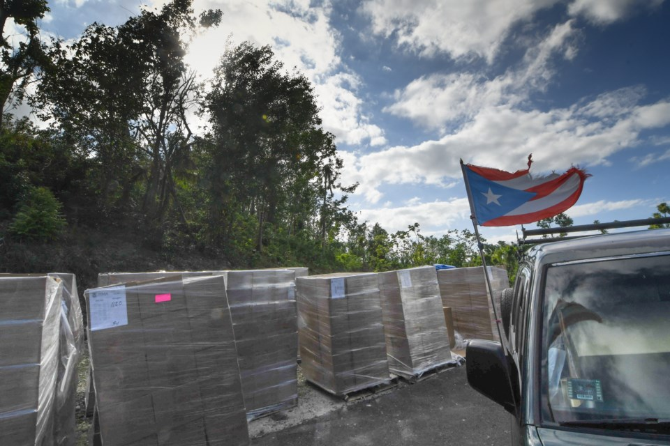 Food arrives at an emergency food distribution in the mountains of Puerto Rico. Photo: Philip Maher