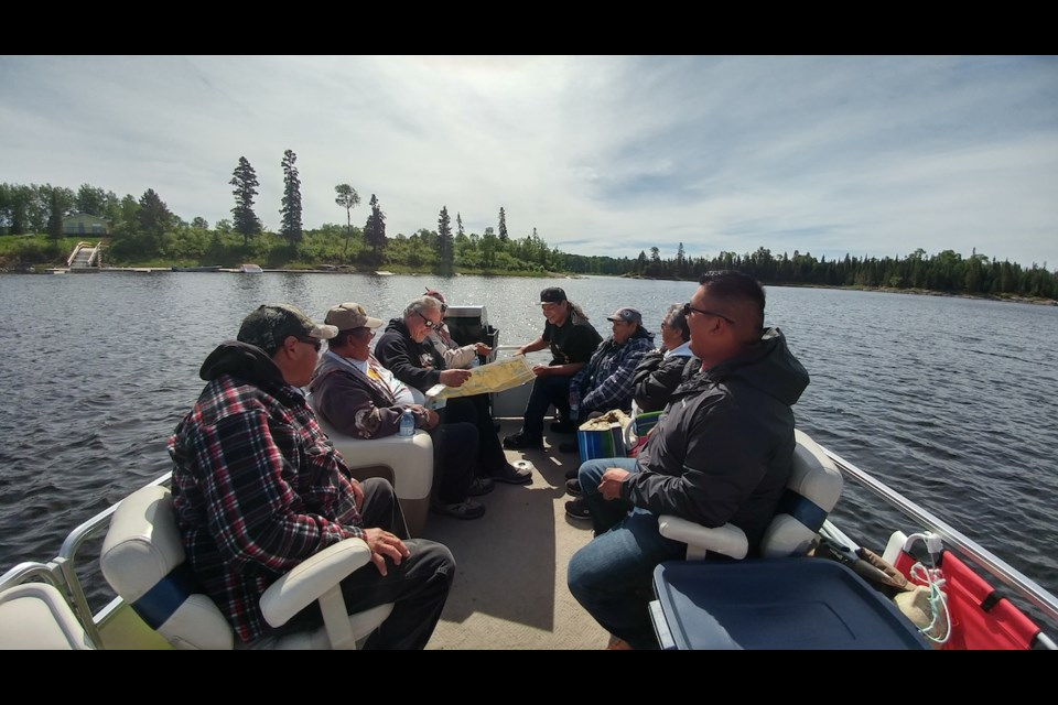During the reconnaissance stage of their study, researchers participated in a day-long boat tour of the Winnipeg River. The youth and knowledge keepers pictured here selected the research sites. Photo courtesy Brittany Luby