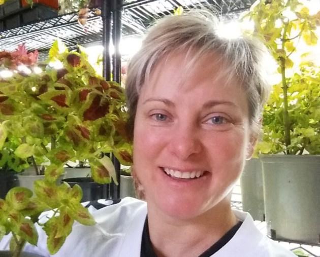cropped Karen Shlemkevich and coleus plant