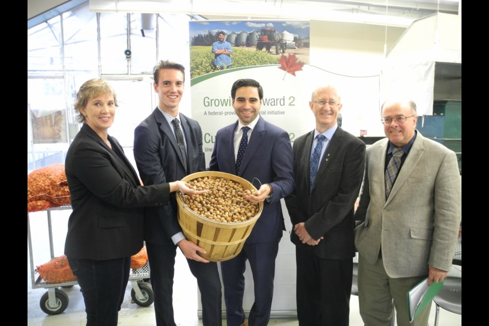 Barbara Yates (Senior Agronomist, Ferrero Canada), Andrew Nixon (Project Manager – University of Guelph/Ontario Hazelnut Association), MP Peter Fragiskatos (London North Centre), Wayne Caldwell (Associate Vice-President Research, University of Guelph), Les High (Secretary/Director Ontario Hazelnut Association) at the announcement. Photo Supplied