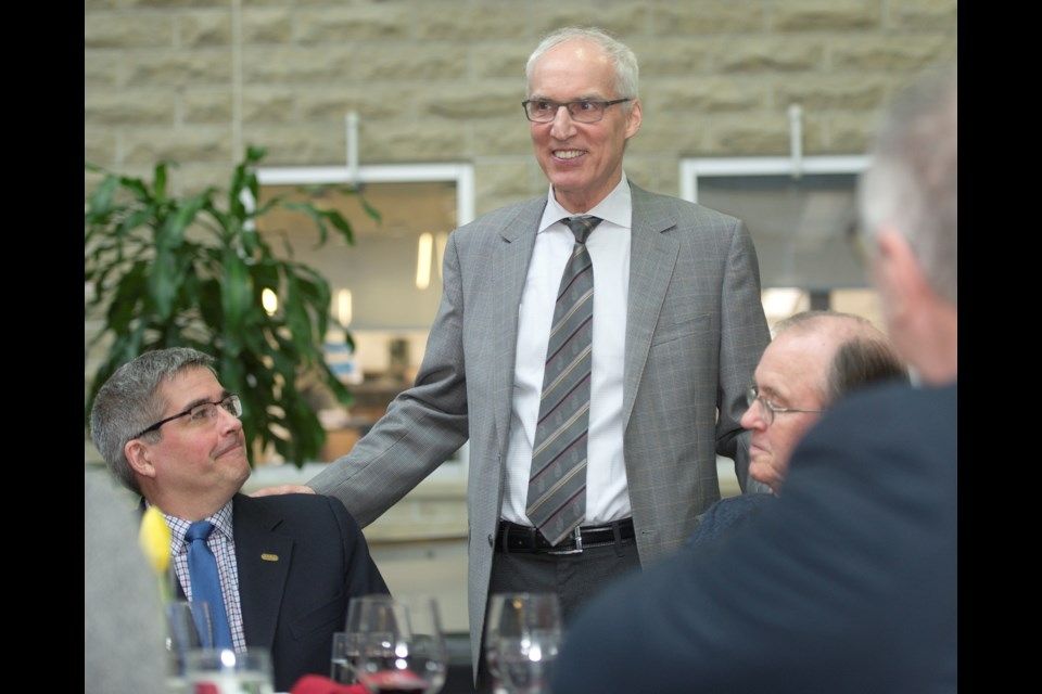 University of Guelph President Franco Vaccarino (standing) visits with researchers John Cranfield (left) and Peter Tremaine. Photo courtesy of Martin Schwalbe
