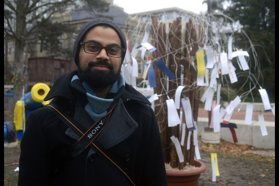Shawn Desouza-Coelho is the founder of The PoeTree, a community-engagement endeavour that allows people to leave, or take, an original poem. Tony Saxon/GuelphToday
