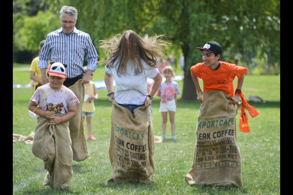 Guelph MP Lloyd Longfield trails the pack in a sack race at the Guelph Neighbourhood Support Coalition's All-Camp Day at Waverley Drive Public School Wednesday. Tony Saxon/GuelphToday