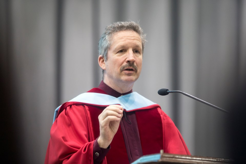 Jim Estill, president and CEO of Danby Products, Ltd., speaks during a U of G convocation ceremony held Tuesday. Estill was presented with an honorary doctorate during the event. Kenneth Armstrong/GuelphToday