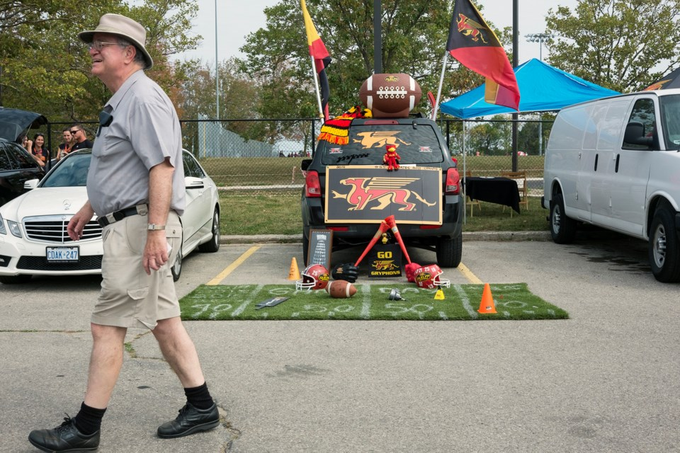 A man walks through an area reserved for University of Guelph alumni immediately  prior to Saturday's football game at Alumni Stadium. Kenneth Armstrong/GuelphToday