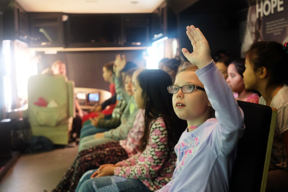 Students in Mr. Kenney's Grade 4-5 class at Mitchell Woods Public School engage in a discussion during the Tour for Humanity travelling exhibit on Wednesday. Kenneth Armstrong/GuelphToday
