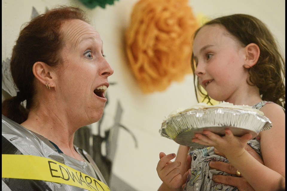Grade 1 student Lola Antler gets ready to put a pie in the face of teacher Victoria Motto at L'Ecole Edward Johnson Public School Tuesday, June 12, 2018. Tony Saxon/GuelphToday