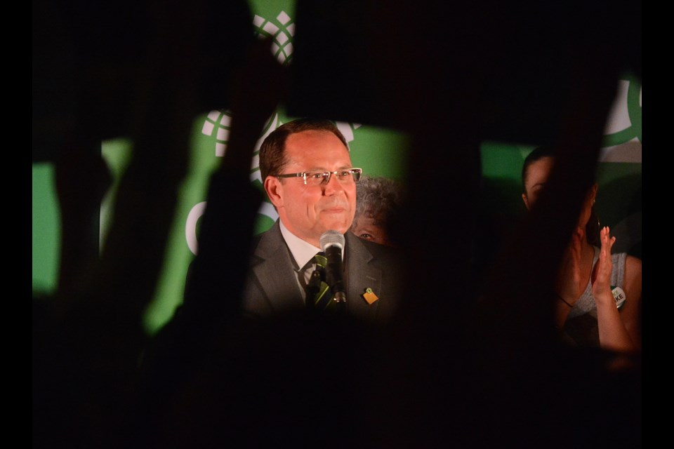 Mike Schreiner pauses as supporters wave placards during his speech after becoming MPP for Guelph Thursday, June 7, 2018, at the Holiday Inn. Tony Saxon/GuelphToday