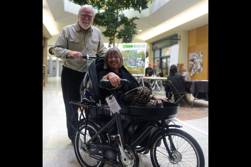 Councillor Bob Bell takes coun. June Hofland for a ride in a Salamander at an event last summer. Bell's Wike company makes the product, which converts from a bicycle cargo/stroller to a hand cargo/stroller and on Thursday night he will pitch it on Dragon's Den. GuelphToday file photo