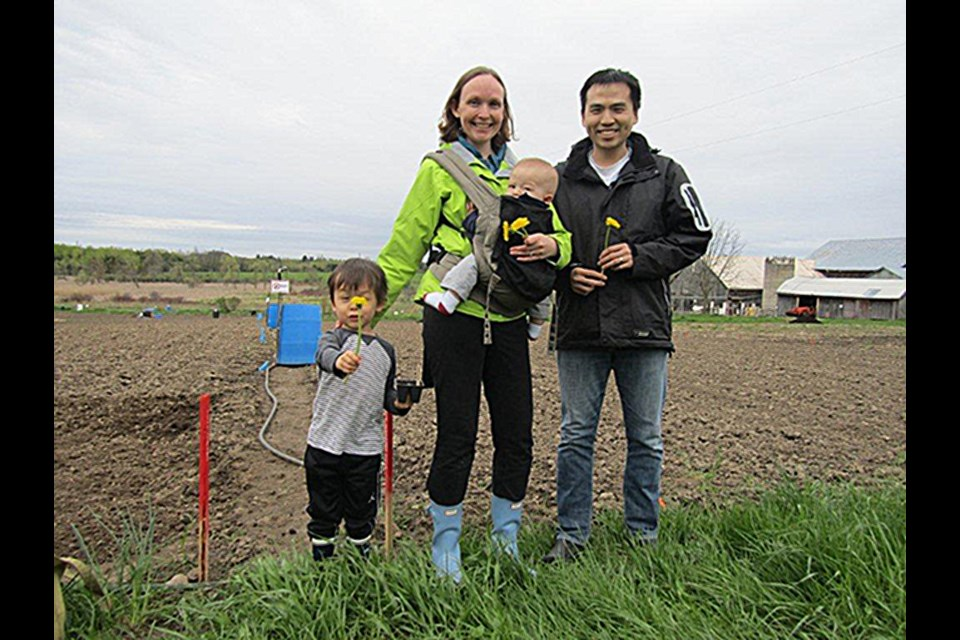 The Wongs have had a garden plot at the Ignatius Centre for years. From left: Isaac, aged 4, Amanda Harrison Wong, Henry, 8 months, and James Wong. Joanne Shuttleworth for GuelphToday.com