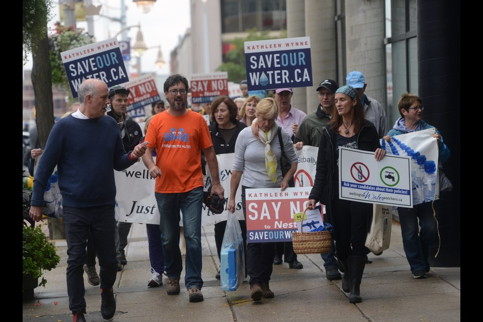 Those attending the Save Our Water rally Friday, Oct. 13, 2017, march up Wyndham Street towards the office of Guelph MPP Liz Sandals. Tony Saxon/GuelphToday