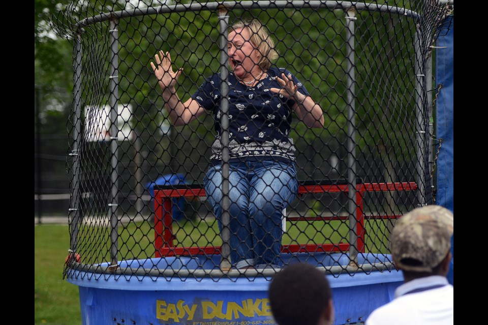 Erin Harvey takes a dunk in the dunking booth at the Shelldale Picnic Friday, July 14, 2017. Tony Saxon/GuelphToday