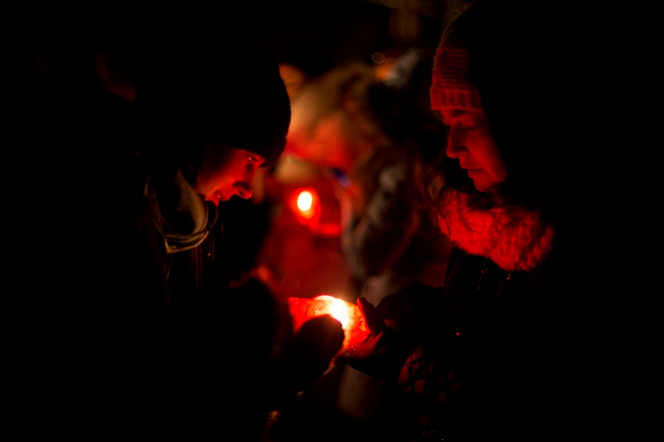 Participants in the Dec. 6th Vigil hold candles in remembrance of the 14 killed  in the 1989 Montreal Massacre and the victims of gender-based violence. Wednesday's event was held at Marianne's Park. Kenneth Armstrong/GuelphToday