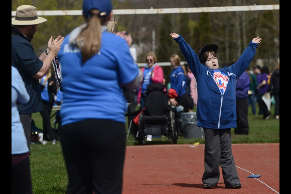 An athlete celebrates their effort at the Special Olympics track and field meet at St. James high school on Wednesday, where elementary and secondary students from both school boards competed. Tony Saxon/GuelphToday