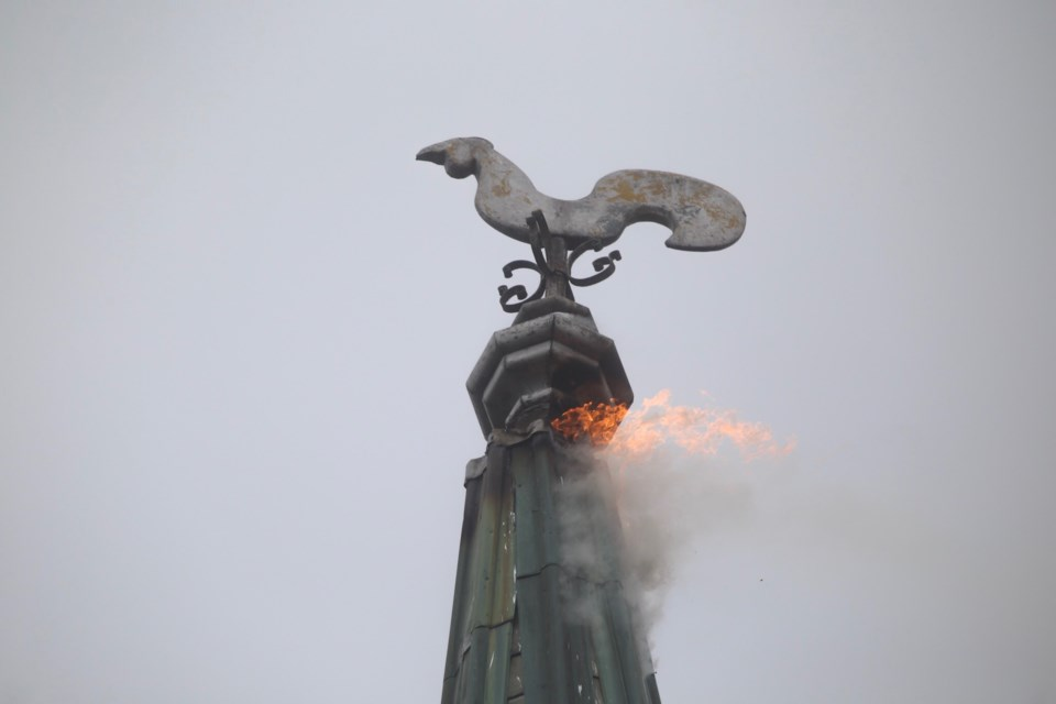 Flames shoot out of the top of the steeple of St. Andrews Presbyterian Church on Aug. 22 after it was struck by lightning. Kenneth Armstrong/GuelphToday