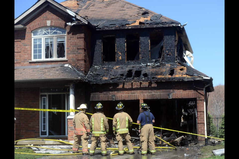 Firefighters survey the damage at 108 Parkinson Dr. in Rockwood after a midday fire badly damaged the home Tuesday, April 18, 2017. Tony Saxon/GuelphToday