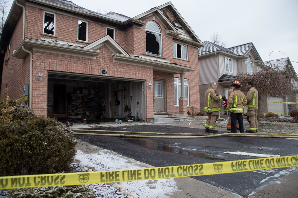 Firefighters with the Guelph Fire Department at the scene Wednesday morning of a house fire that happened overnight on Tovell Drive.
