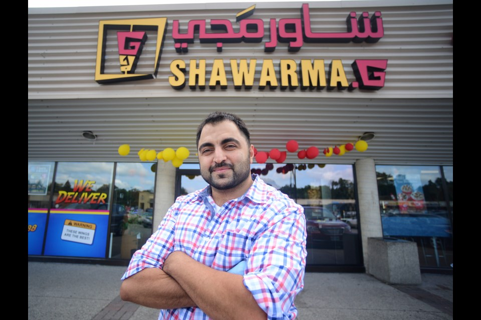 Walaa Allaf stands outside the new Shawarma.G in the Speedvale Plaza. The business is owned by, and employs, Syrian refugees. Tony Saxon/GuelphToday