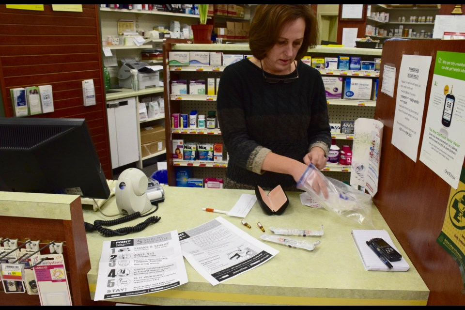 Pharmacist Lisa MacEachern unboxes a naloxone kit. They are available for free through a pharmacy most everywhere in Ontario. Rob O'Flanagan/GuelphToday