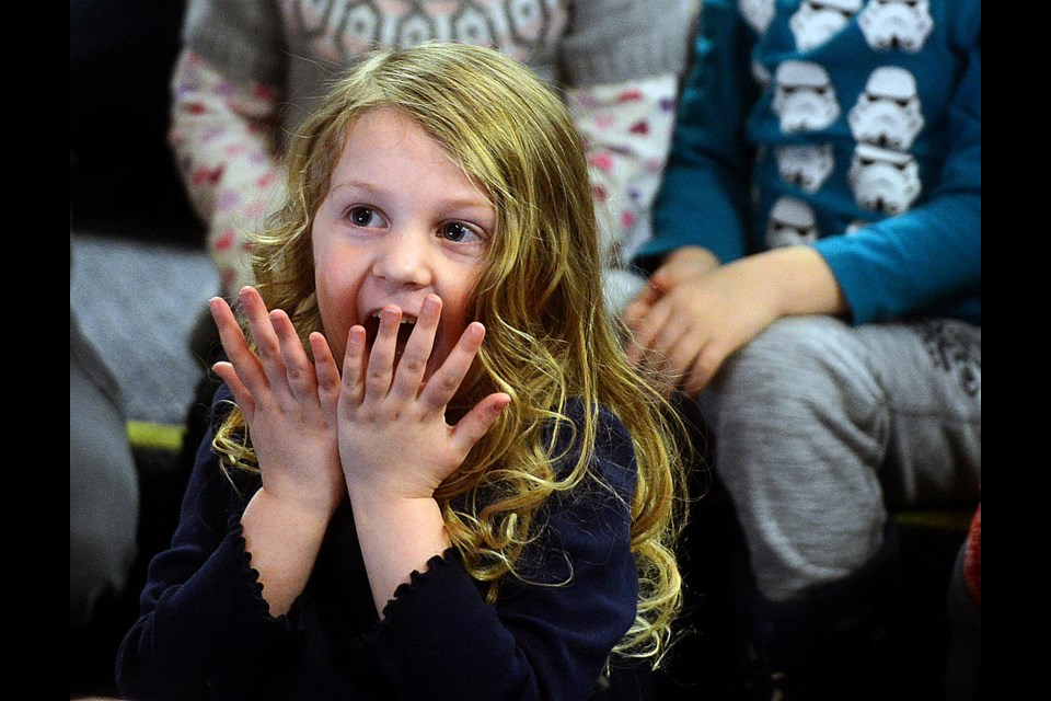 A young girl watches Bumbling Bert perform magic at the Guelph Public Library's main branch Wednesday, Jan. 3, 2018. Tony Saxon/GuelphToday