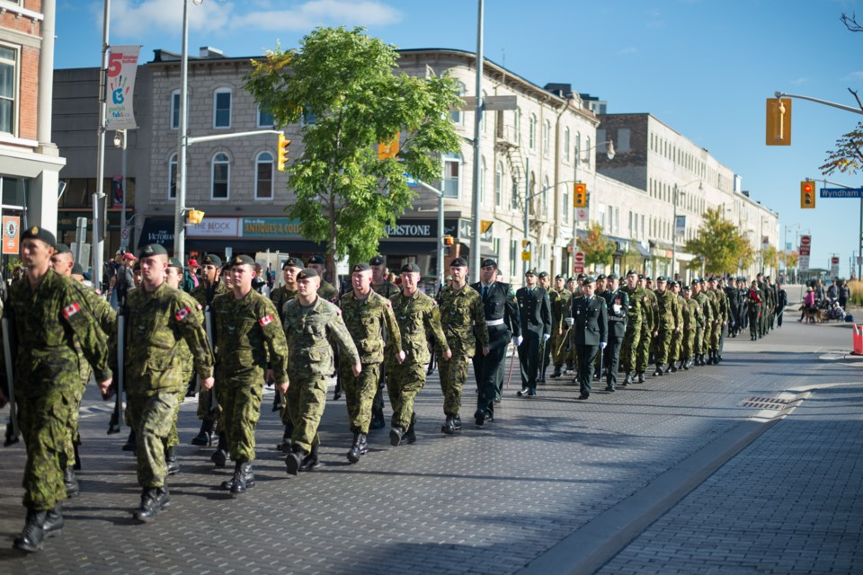 Members of the 11th Field Regiment, RCA march onto Carden St in front of Old City Hall during their Freedom of the City parade for their 150th Anniversary of Artillery of Guelph celebration. Photo by Cara Chapman