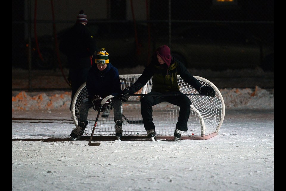 Taking a breather after some night shinny at Sunnyacres Park. Tony Saxon/GuelphToday