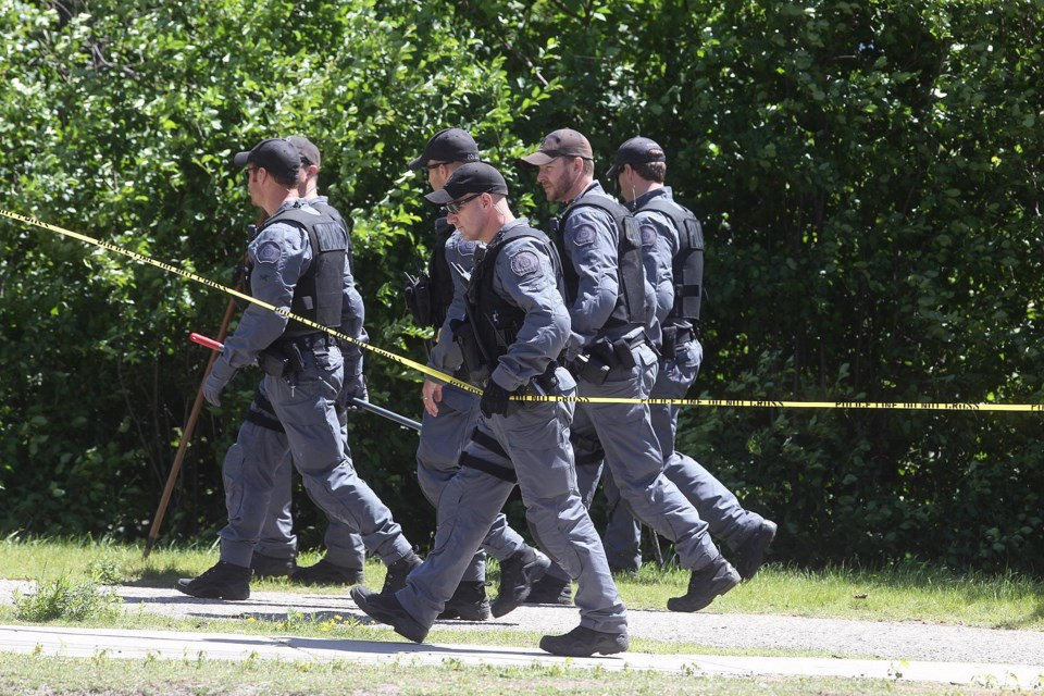 Police search in the area of Arthur Street and Wellington Street Thursday after a body was pulled from the Speed River Wednesday night. Kenneth Armstrong/GuelphToday